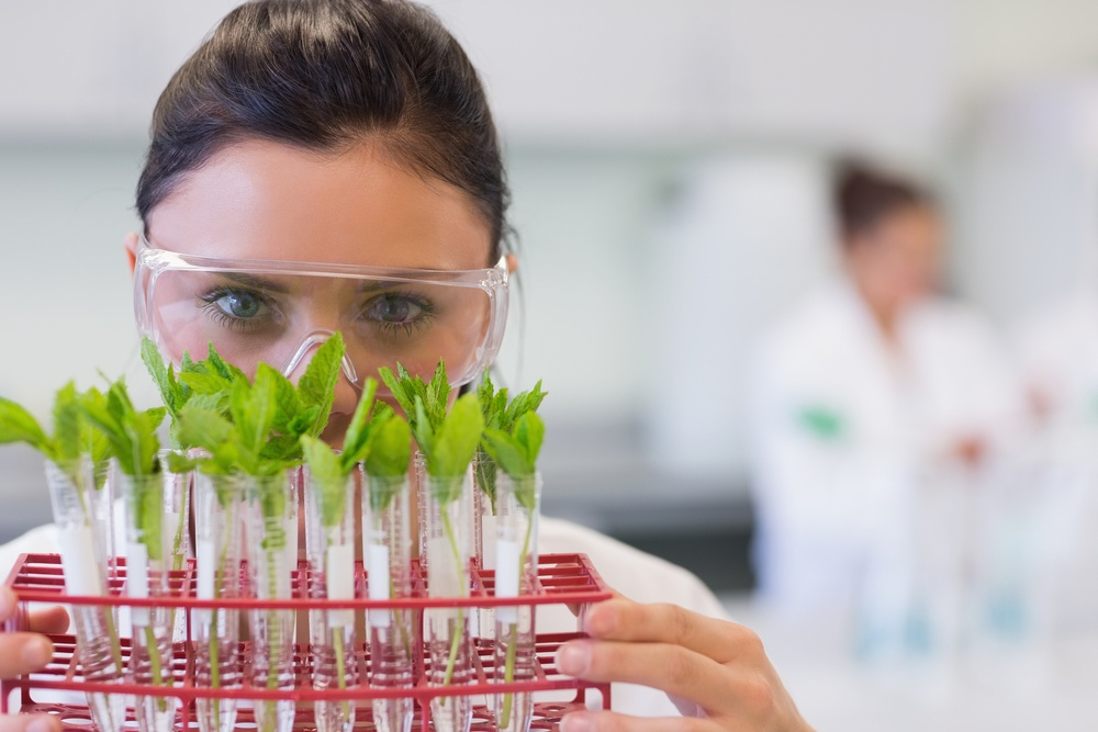 Close-up portrait of a female scientist with young plants at the laboratory-1